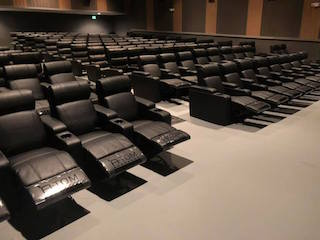 With more than 2,700 chairs ordered for four of its locations in the United States, Rochester Theater Management has begun installing Luxury Recliners, Gliders and Rockers from Spaces And Between's Atom Seating division.