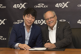 Brandon Choi, CEO of CJ 4DPlex America, left, with Ellis Jacob, president and CEO, Cineplex.