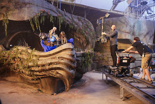 The set was an unusual one. The warehouse ceiling was already fairly low, and with a four-foot rostrum in place to allow the puppeteers to move around the different scenes (all exteriors were also shot inside), the shooting space became even narrower. Photo by Kevin Baker, Netflix