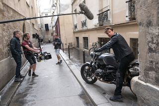 Left to right: director Christopher McQuarrie, B camera/Steadicam operator Marcus Pohlus and Tom Cruise on the set of Mission Impossible – Fallout, from Paramount Pictures and Skydance. The Lectrosonics SMV transmitter is located next to the wind-protected shotgun microphone.