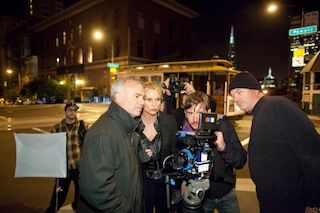 Checking a shot from the short movie Xxit are, left to right: director Sam Nicholson, actress Nicollette Sheridan, AC Richard Card, and DP Dana Christiaansen.