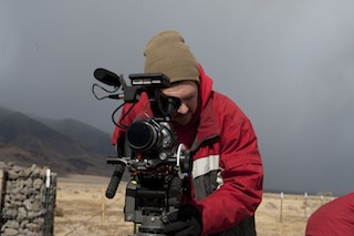 Joel Stout checking a shot. Weather extremes and dust were a big challenge on the shoot.