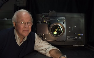 Douglas Trumbull with a Christie Mirage 4K35 laser projector.