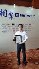 Christie China senior sales manager, entertainment solutions, Shuai Zhen with the award trophy and certificate.