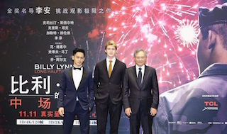 Left to right, Billy Lynn actors Mason Lee and Joe Alwyn and director Ang Lee.