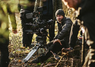 Cinematographer Wes Johnson on location for Instrument of War. Photo by Luke Salnas.