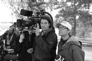 Cinematographer Johan-Fredrik, with the camera, and AC Jens Patterson, in the white hat, on set.