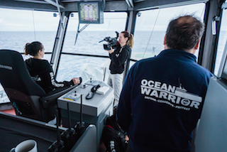 Producer and camera operator Ashleigh Allam films with the DVX200 on the bridge of the M/Y Ocean Warrior off the coast of Antarctica. ©Gavin Garrison/Sea Shepherd Global.