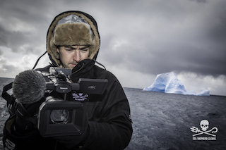 Producer and cinematographer Gavin Garrison films a field of icebergs using the DVX200 on the deck of the M/Y Ocean Warrior off the coast of Antarctica.  ©Simon Ager/Sea Shepherd Global.