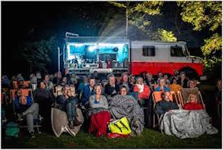 I thought it would make sense to get some perspective about what's involved in that kind of business from the people at Cinemobeil in Belgium, a group of friends who, for the past 20 years, have been presenting movies from a fire truck in towns all across their country.