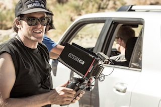 Jonny Zeller peers into SmallHD AC7 monitor as Craig Coker operates the MōVI stabilizer